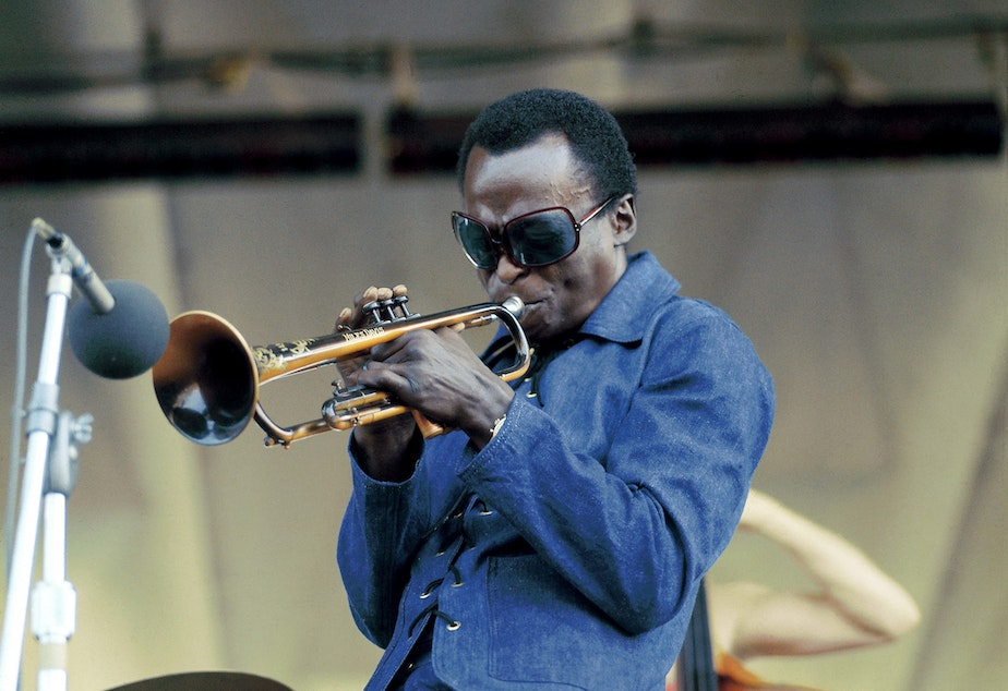 caption: Miles Davis performing at Newport Jazz Festival in 1969.