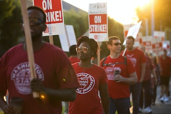 Katrice Cyphers, second from left, marches with teachers on strike outside of Foster High School on Tuesday, September 5, 2018, in Tukwila.