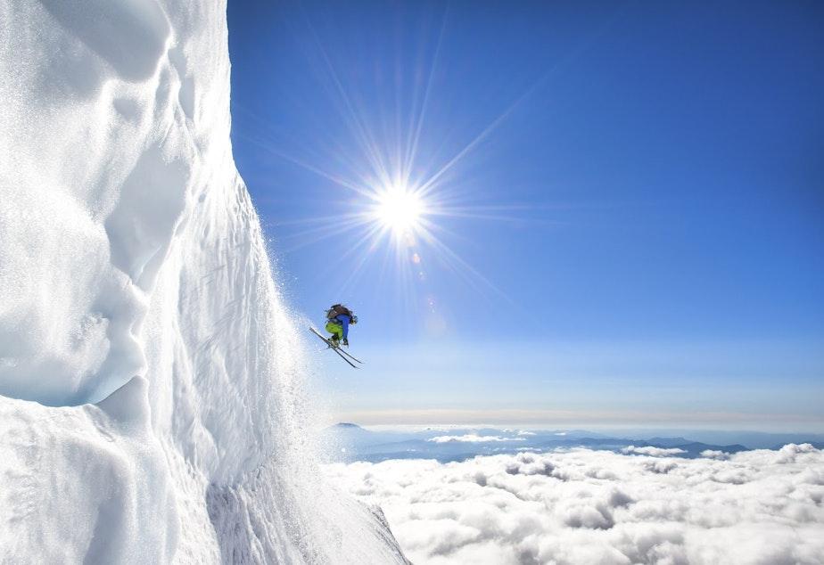 Jason Hummel photographs a skier making his way down Mt. Adams