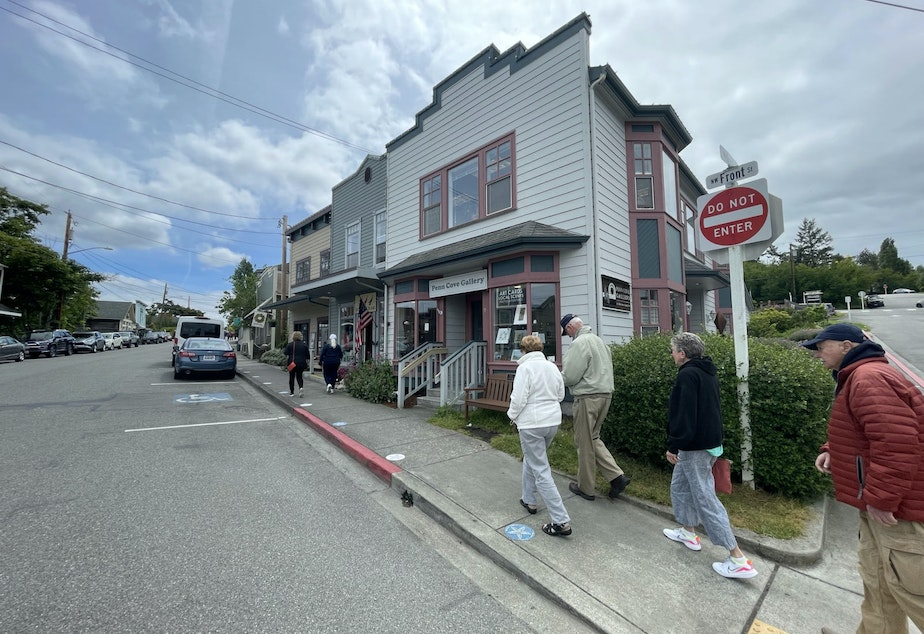 caption: Tourists on Front Street in Coupville