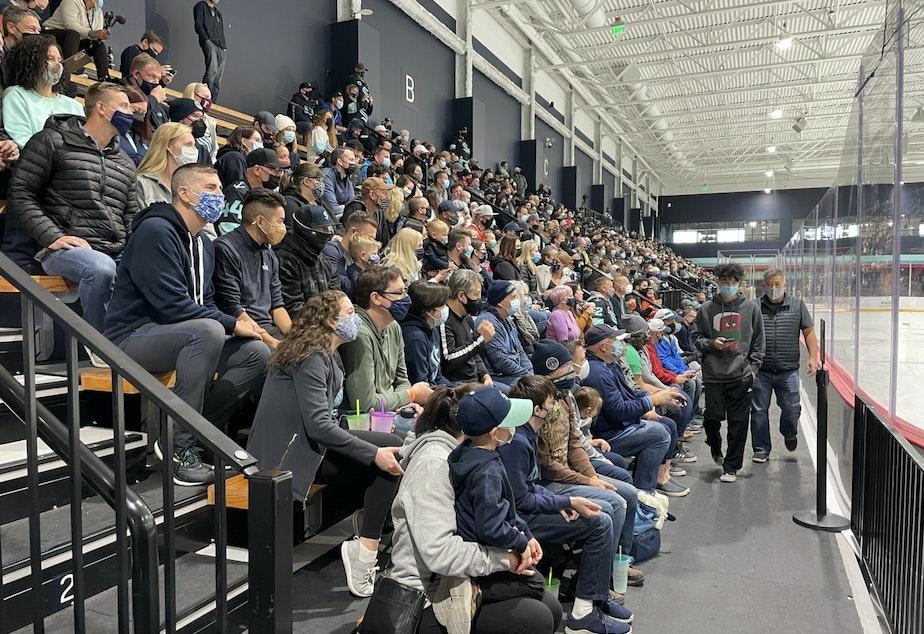 caption: Kraken fans watch hockey practice at the Northgate Community Iceplex.