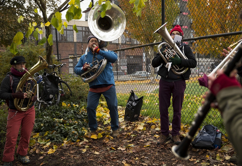 caption: A band performs during an impromptu celebration after Joe Biden was officially named the president elect on Saturday, November 7, 2020, at the intersection of 10th Avenue and East Pine Street in Seattle.