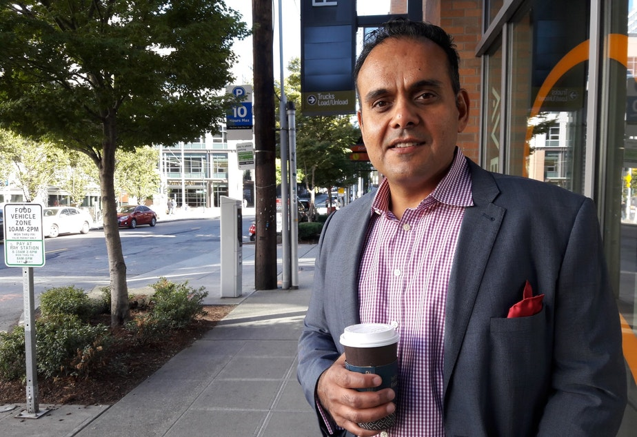 caption: Sunjay Pandey, a former Amazon product manager, now runs Capital One's innovation lab, practically on the doorstep of Amazon's South Lake Union headquarters.