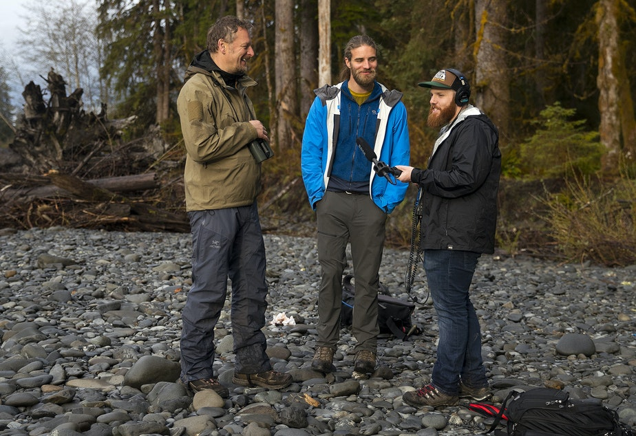 From left, Chris Morgan, Matt Mikkelsen, and Matt Martin, record an episode of The Wild while hiking to One Square Inch of Silence on Friday, April 5, 2019, in the Hoh Rainforest on the Olympic Peninsula.