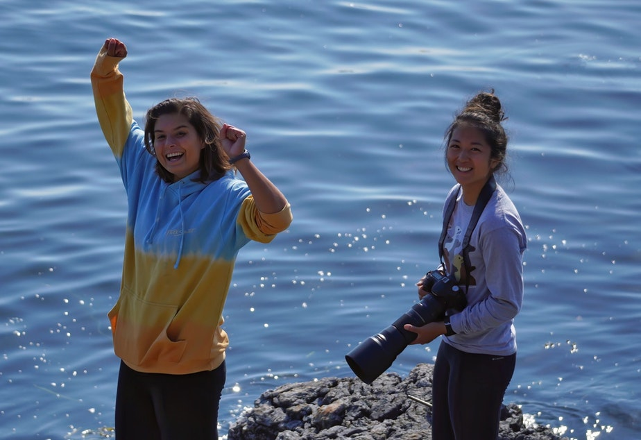 caption: Oceans Initiative researcher Andrea Mendez-Bye (L) and Catherine Lo celebrate the successful deployment of an underwater microphone off the west side of San Juan  Island.