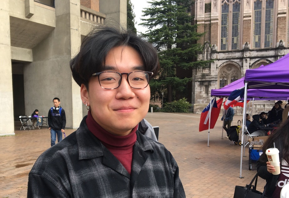caption: University of Washington sophomore Sicheng Wang on the campus's Red Square