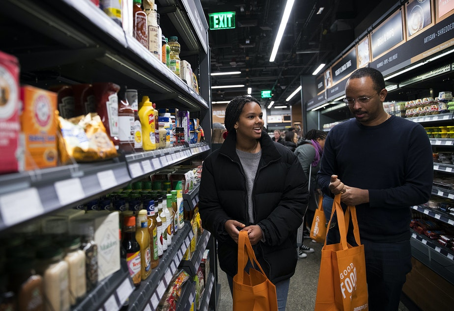 Mary Haddish, 14, left, shops with her father, Daniel Ghebre at Amazon Go on Monday, January 22, 2018, on 7th Ave., in Seattle.