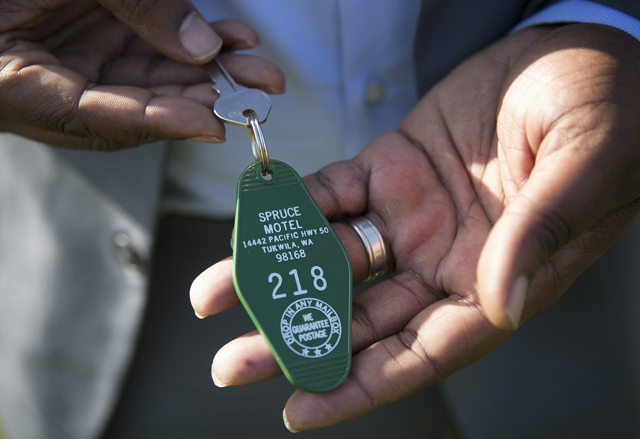 De'Sean Quinn shows his prized possession: the key to one of the motels that used to dominate Tukwila's stretch of the old highway 99.