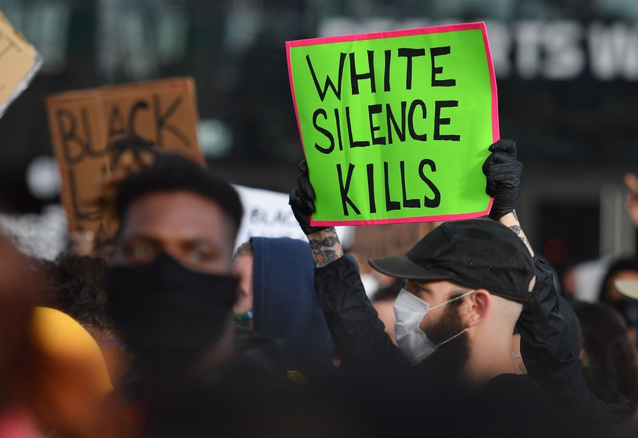 """caption: <em>White Fragility </em>author Robin DiAngelo says the question white people should be asking themselves is not: Have I been shaped by race, but <em>how</em> have I been shaped by race? Above, protesters at a """"Black Lives Matter"""" demonstration on June 1, 2020 in New York."""