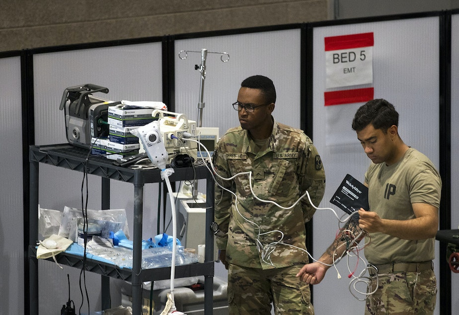 caption: U.S. Army soldiers store medical equipment in the EMT area of the military field hospital inside CenturyLink Field Event Center on Sunday, April 5, 2020, in Seattle. The 250-bed hospital for non COVID-19 patients was deployed by U.S. Army soldiers from the 627th Army Hospital from Fort Carson, Colorado, as well as soldiers from Joint Base Lewis-McChord.