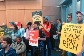 Supporters of the high earner income tax pack a city hall meeting in July