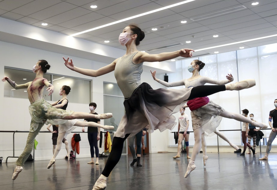 caption: Ballet dancers in Shanghai rehearse while wearing masks on March 2. A virus first identified in December has altered daily life and public spaces around the globe.