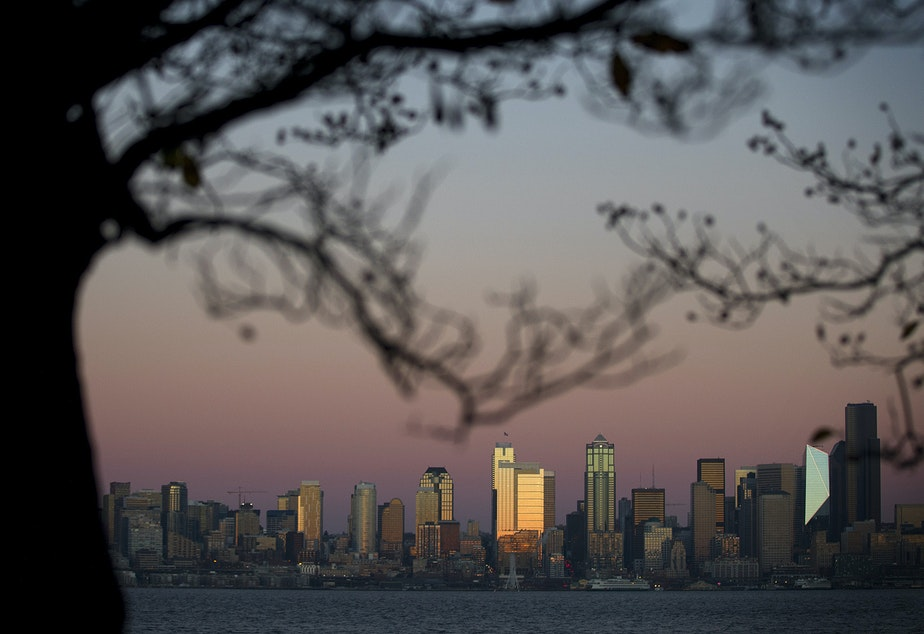 caption: The sun sets on downtown Seattle on Tuesday, December 5, 2017.