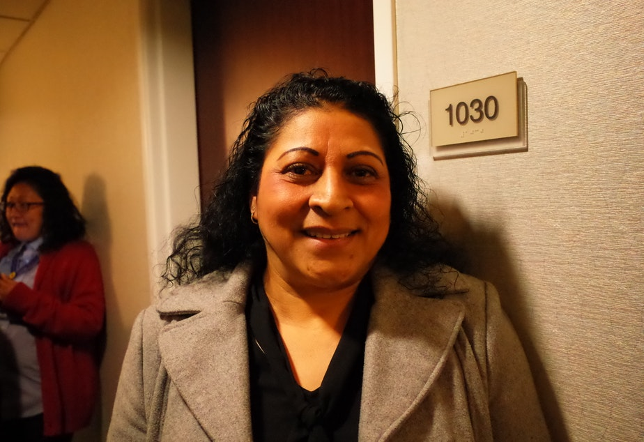 Maria Estrada, in a hallway at the Springfield Suites hotel. She words at the Hilton Seattle.