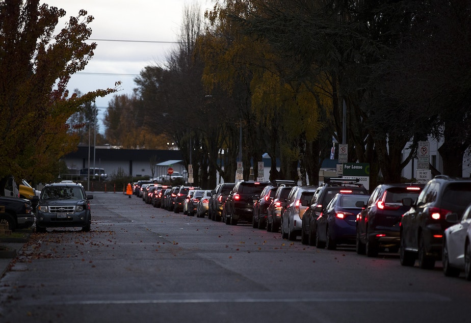 caption: A line of vehicles is shown on Wednesday, November 18, 2020, at the Covid-19 testing site on Southwest 10th Street in Renton.