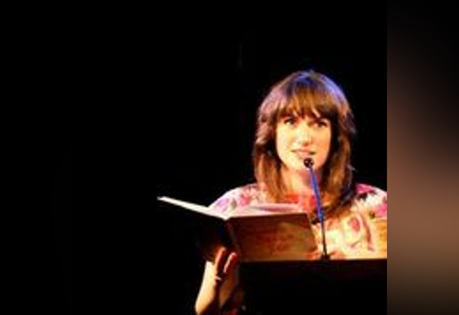caption: Poet and pie maker Kate Lebo, reading at Richard Hugo House.