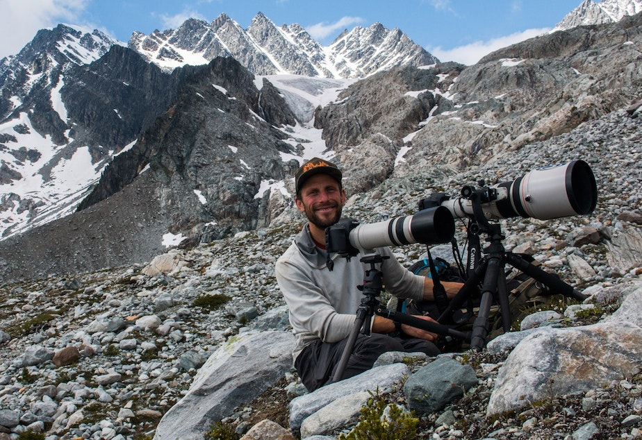 caption: Wildlife tracker and photographer David Moskowitz in the Selkirk mountains in Glacier National Park in BC during the filming of a documentary about Mountain Caribou.