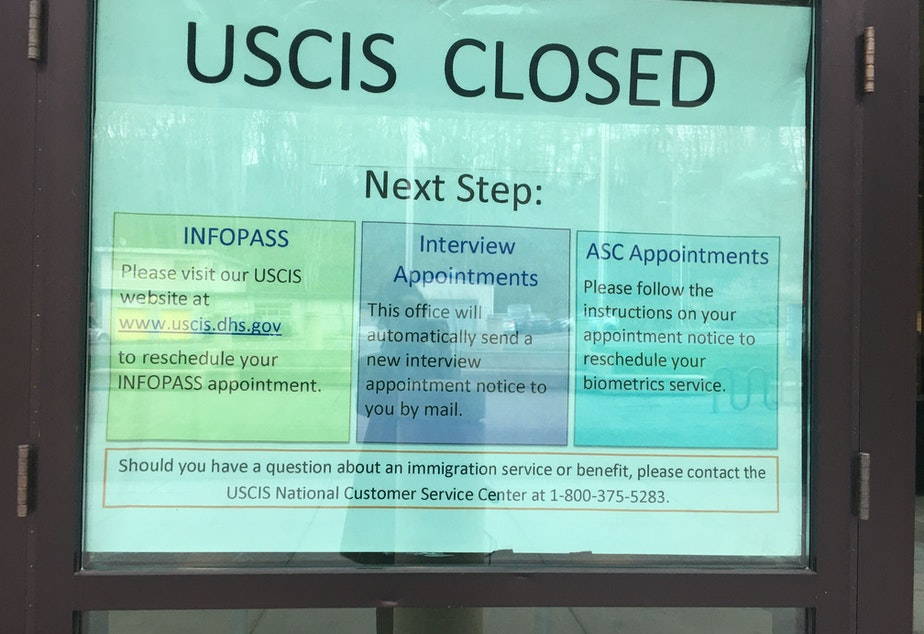 caption: On the door outside the Seattle USCIS office, officials ask immigrants to reschedule their appointments. March 03, 2020.