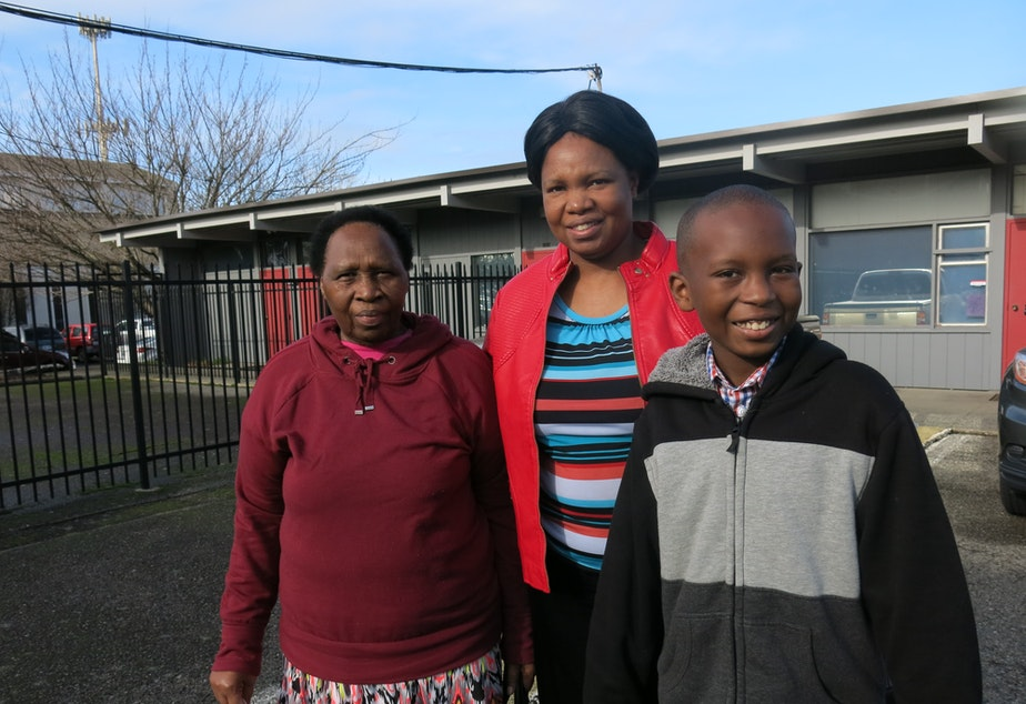 Emily Muchemi, center, with her mother Ejidiah Wanjiru and her son in fourth grade at St. Francis Cabrini school.