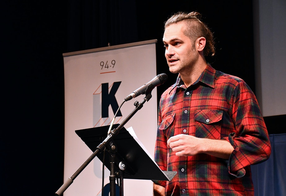 Garth Donald performs his story 'A Cabin Recalled' at KUOW's Stories from the Wild event on Friday, October 11, 2019 at McCaw Hall in Seattle.