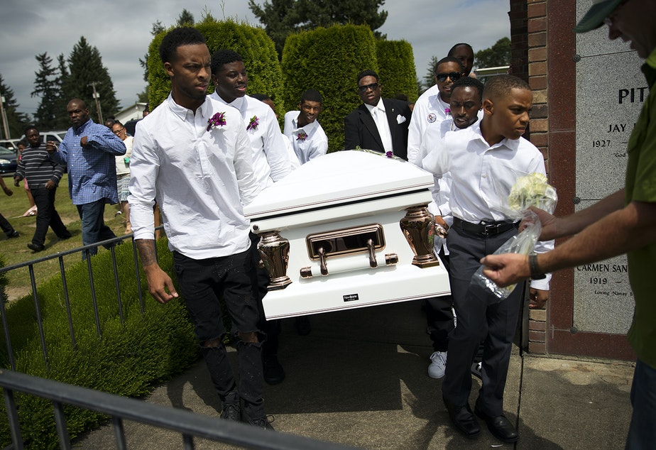 caption: Pall bearers carry the casket of Charleena Lyles during a burial ceremony at Hillcrest Burial Park on Monday, July 10, 2017, in Kent, Washington.