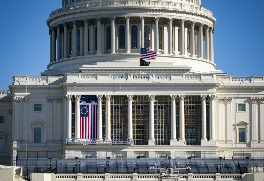 caption: The American flag flies at half-staff on the west front of the U.S. Capitol on Saturday. On Monday, House Democrats introduced an impeachment resolution against President Trump over his role in last week's insurrection.