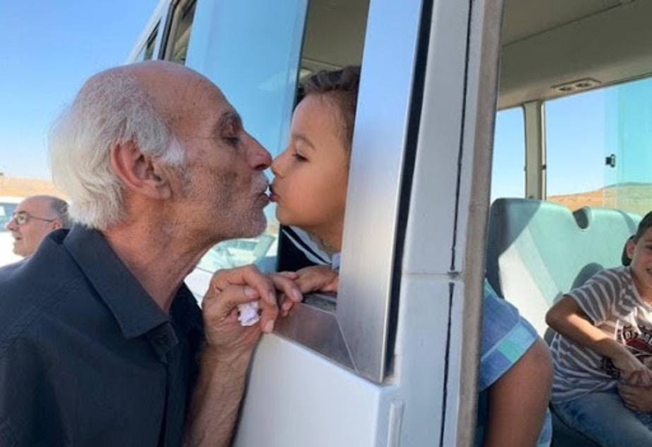 caption: Grandpa saying goodbye to grandson in Syria