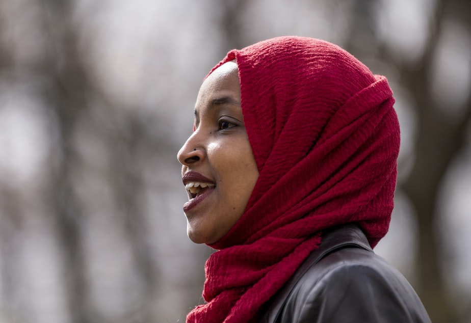 caption: Rep. Ilhan Omar, D-Minn., seen here at a press conference in April, issued a clarification Thursday of comments she made that appeared to equate the United States and Israel to Hamas and the Taliban.