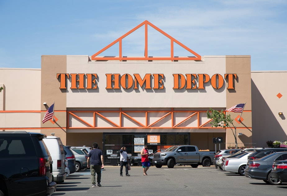 caption: Customers outside the Home Depot in Tukwila on Tuesday, July 14, 2020.