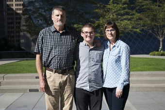 From left, Mark, Paxton and Cheryl Enstad pose for a portrait on Thursday, October 5, 2017, outside of the ACLU of Washington on 9th Ave., in Seattle.
