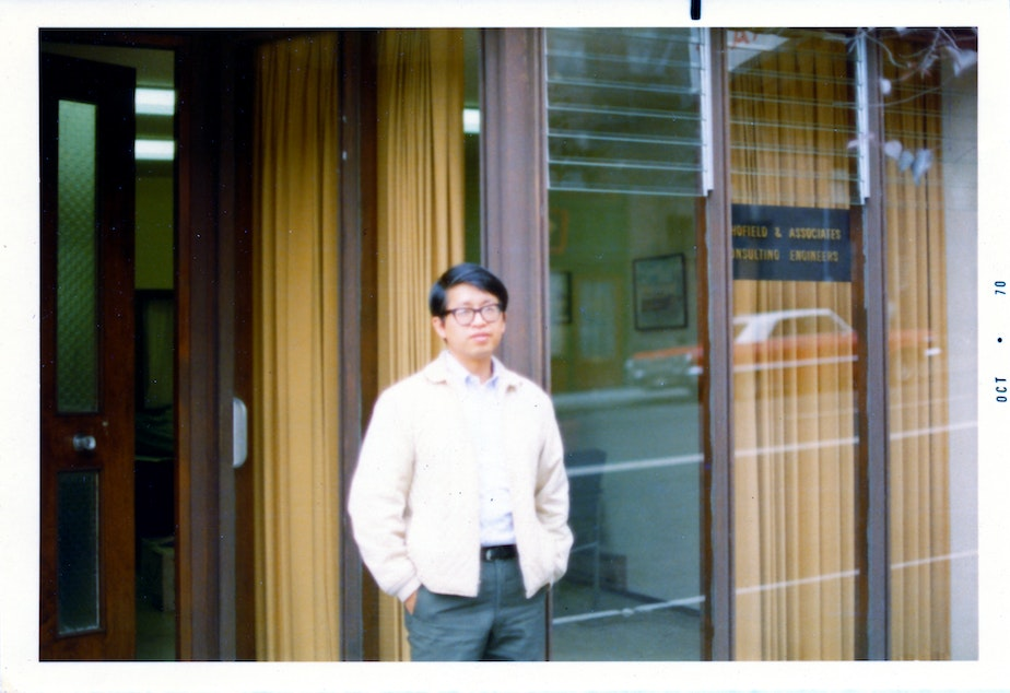 Paul Woo stands in front of the Louisa Hotel building where he ran a law office (photo circa 1970).