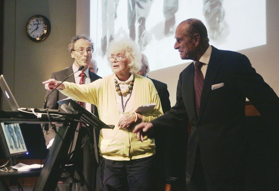 caption: In this May 29, 2013 file photo, travel writer, journalist and author, Jan Morris, center, with the Duke of Edinburgh, right, during a reception to celebrate the 60th Anniversary of the ascent of Everest, at the Royal Geographical Society in London.