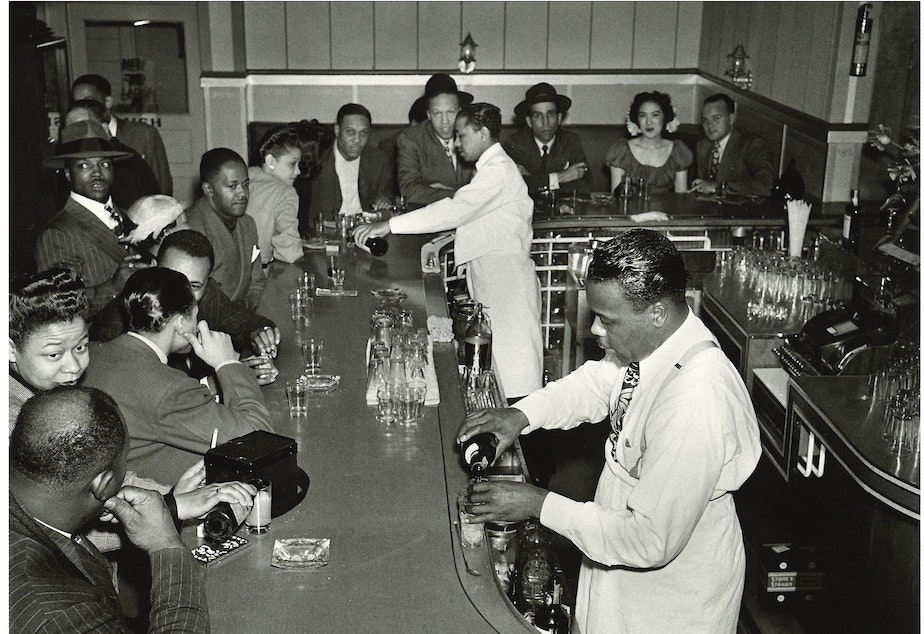 The Rocking Chair, 1946, an after-hours club, known for being where Ray Charles launched his reputation. (To help us ID these bartenders and patrons, note the photo number. This is #13.)