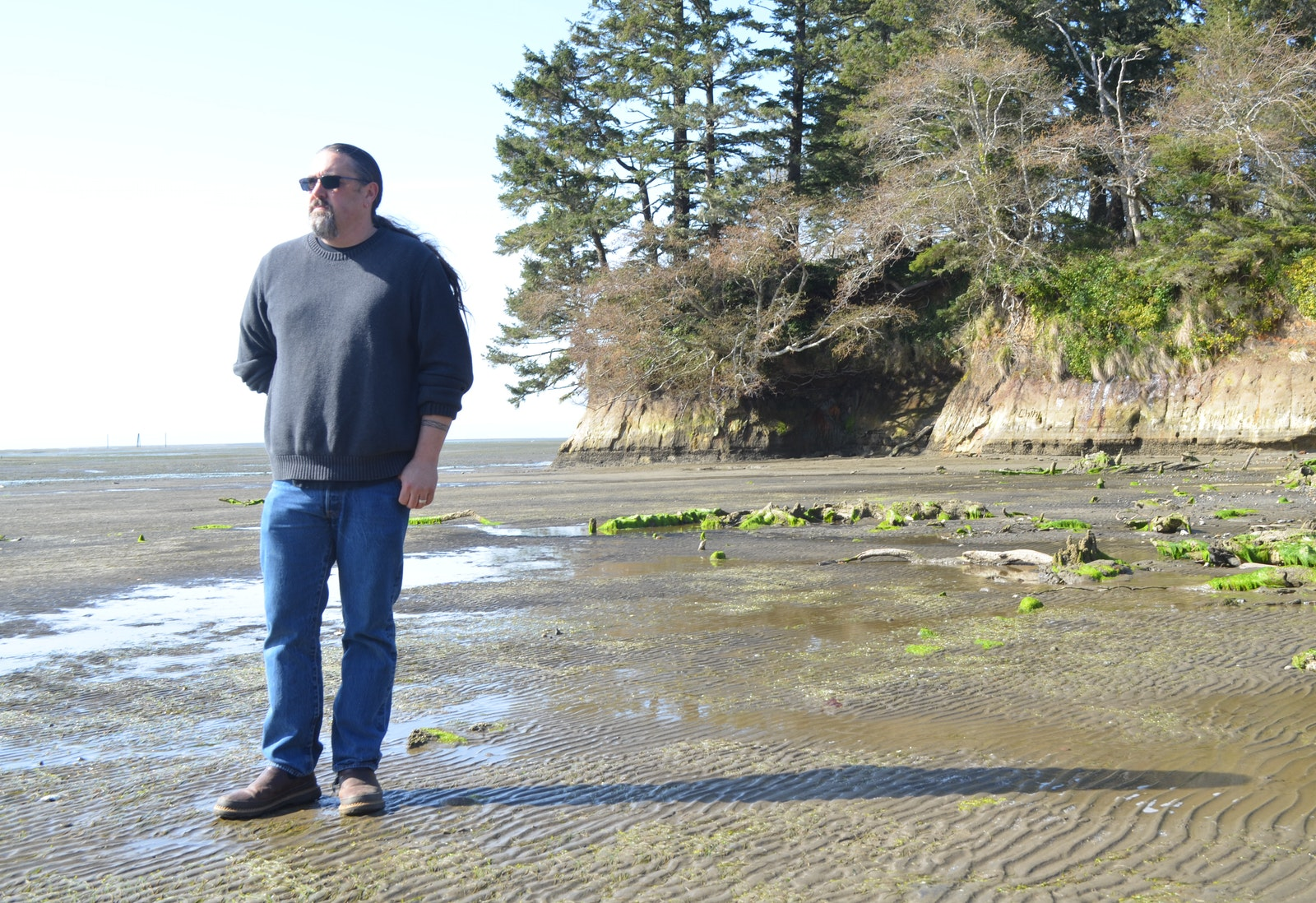 Troy Johnson standing on the beach
