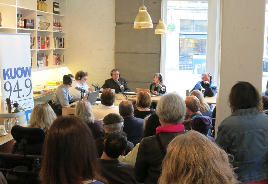 caption: The 'Week in Review' panel broadcasts in front of a live audience at Little London Plane in Pioneer Square on Friday, Jan. 9, 2015.