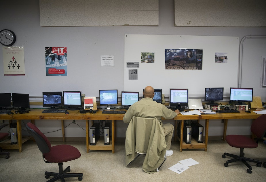 caption: Greg Steen, an inmate at the Clallam Bay Corrections Center, looks for 'Hollywood' or 'Facebook' clips of wildlife on Thursday, January 30, 2019, on the Olympic Peninsula.