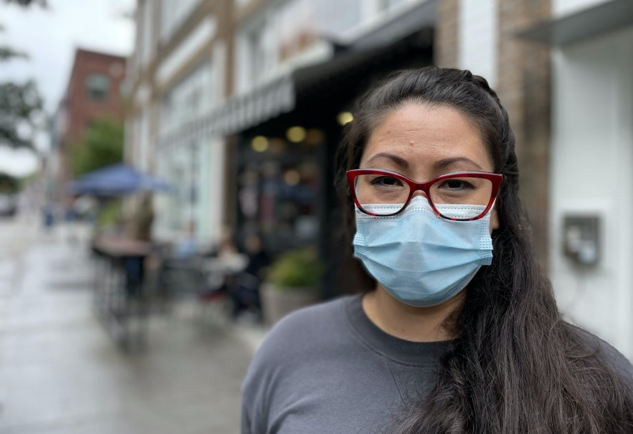 caption: Miki Sodos outside Cafe Pettirosso in Seattle's Capitol Hill neighborhood