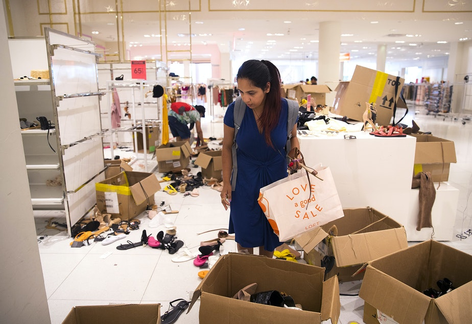 Shivangi Mishra looks through boxes of shoes at Forever 21 on Monday, July 22, 2019, at Northgate Mall in Seattle.