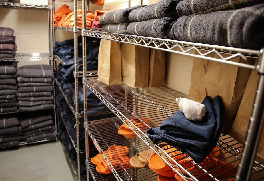 Socks, sandals, clothing and blankets line the shelves of a stock room at the Deschutes County Jail in Bend, Ore., Tuesday, March 12, 2019. In Oregon, jails must comply with a set of statewide standards that govern everything from riot control to a requirement that mattresses and blankets be fire-retardant.