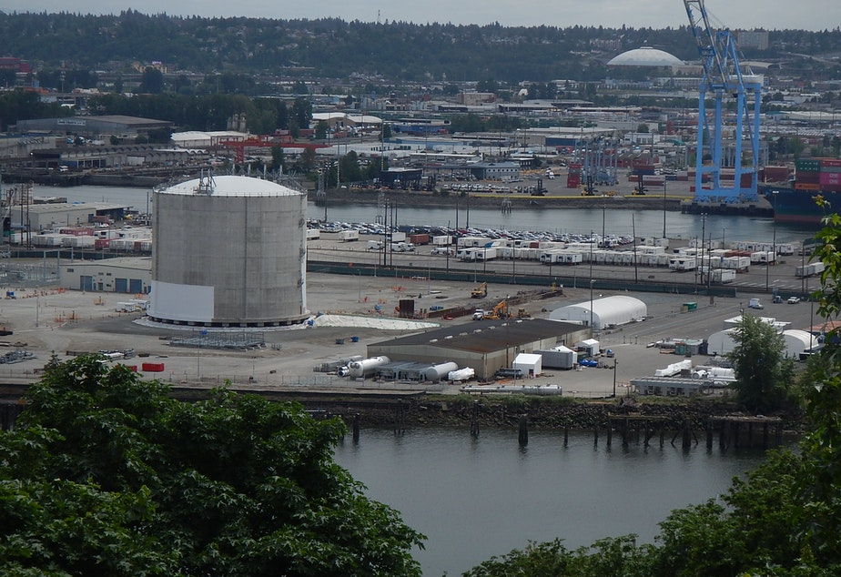 Puget Sound Energy's liquid natural gas tank (foreground) is about as tall as the Tacoma Dome (background).