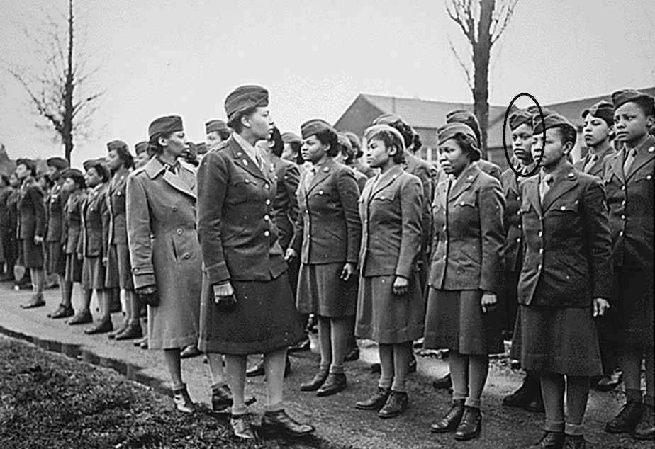 caption: Indiana Hunt Martin is shown (circled) in England in February 1945 as the 6888th Central Postal Directory Battalion is reviewed by their commander, Major Charity Adams.