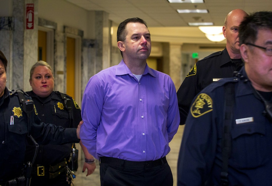 caption: Joseph McEnroe was found guilty in the 2007 murders of his ex-girlfriend's family -- four adults and two children.