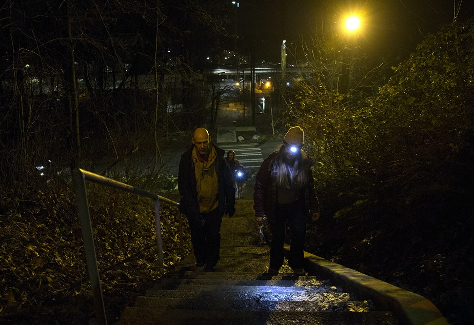 Volunteer Joanna Bomba-Grebb, right, walks with guide Daniel Long during the annual point in time count of people experiencing homelessness in King County on Friday, January 25, 2019, in the Beacon Hill neighborhood of Seattle.