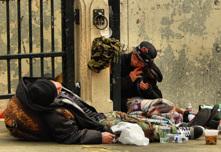 Two people experiencing homelessness in Seattle's University District.