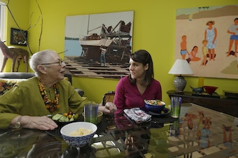Laura Berick, left, a retired art dealer, has lunch with Justine Myers at Berick's home in Judson Manor, in Cleveland, Feb. 17, 2017. (Tony Dejak/AP)