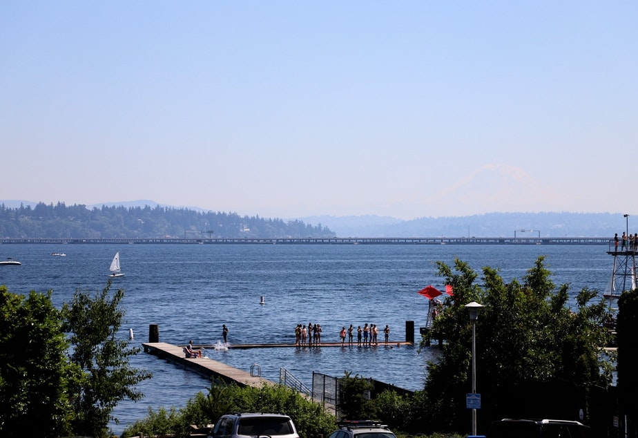 caption: A view of the docks at Laurelhurst Beach Club on Monday, June 28, 2021, on a record breaking day for temperature in Seattle. The mercury reached 107 degrees.