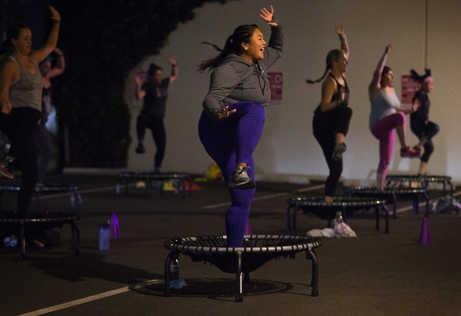 caption: Anna-Marie Lim, center, participates in an outdoor bounce and sculpt class led by Allison Axdorff, not pictured, on Tuesday, October 13, 2020, at Upbeats fitness studio along NW Leary Way in Seattle.