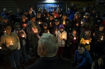 Members of the DuPont community gather to listen to mayor Mike Courts during a candlelight vigil on Wednesday, December 20, 2017, at DuPont City Hall in DuPont.  Tap or click on the first image to see more.