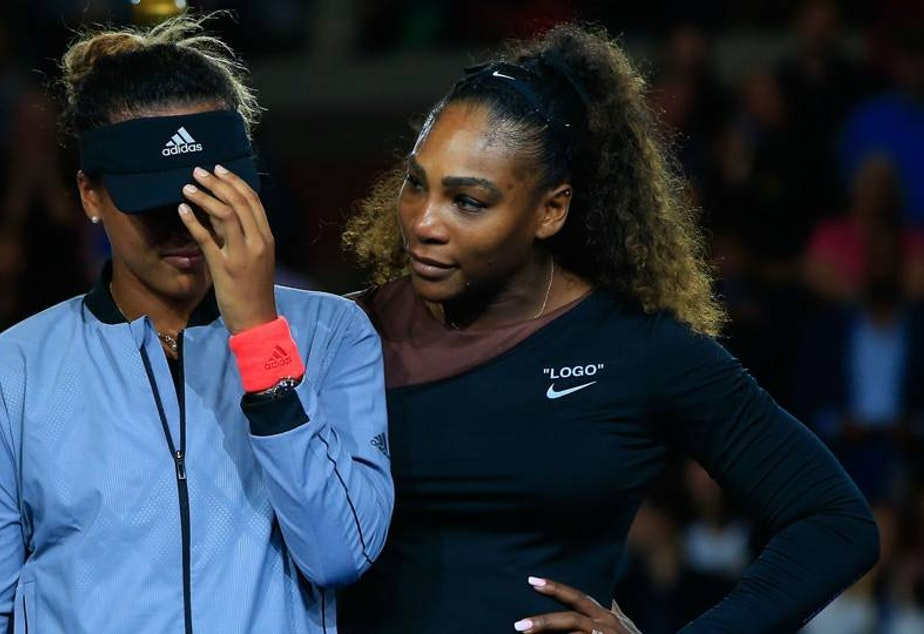Serena Williams (R) of the United States comforts Naomi Osaka (L) of Japan after Osaka won the Women's Singles finals match on Day Thirteen of the 2018 US Open at the USTA Billie Jean King National Tennis Center on September 8, 2018 in the Flushing neighborhood of the Queens borough of New York City.