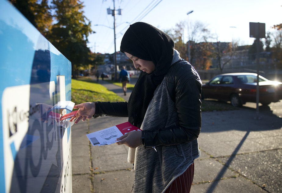 caption: Sarya Sos drops off ballots on behalf of community members on Tuesday, November 5, 2019, at the Rainier Community Center in Seattle.